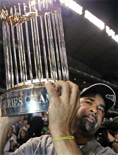 Chicago White Sox manager Ozzie Guillen holds up the World Series trophy after defeating the Houston Astros in Game 4 to win the World Series, Wednesday, Oct. 26, 2005, in Houston.  <span class=meta>(AP Photo&#47;Jeff Roberson)</span>